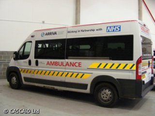 An ambulance parked inside an ambulance unit.